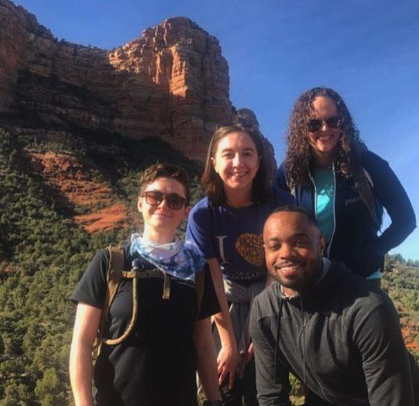 students pose for picture while hiking